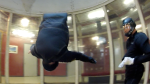 Todd Love working on front flips in the windtunnel with Instructor Niklas Daniel of AXIS Flight School.