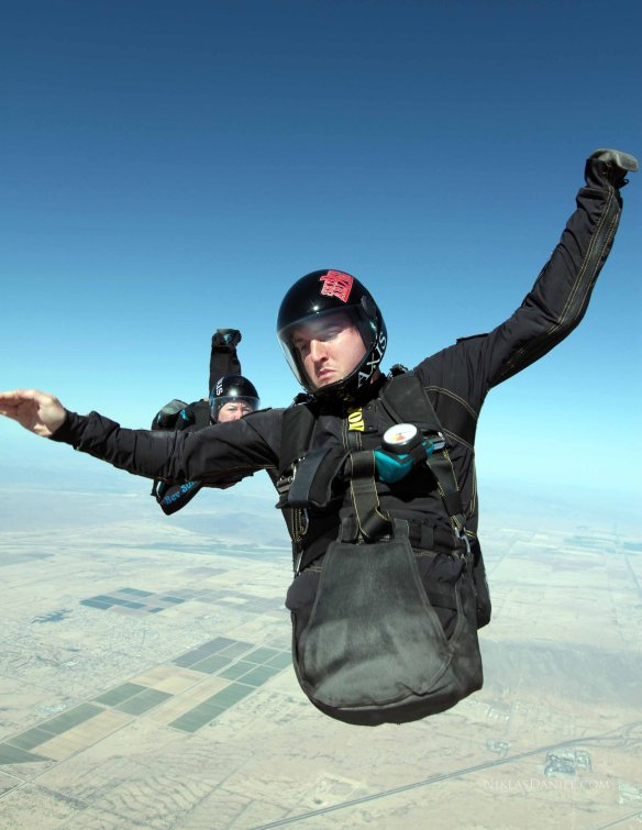 Todd demonstrates control in free fall by recovering from  a front flip.